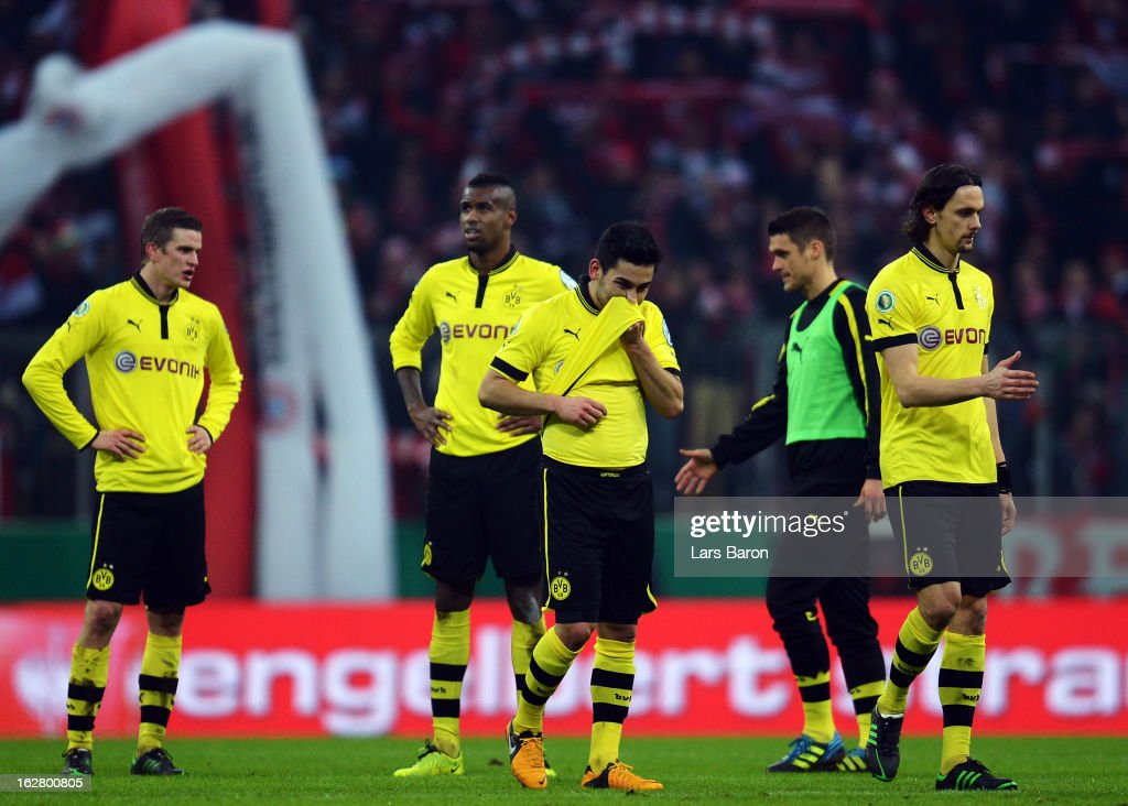 Ilkay Guendogan of Dortmund and his team mates are looking dejected after loosing during the DFB cup quarter final match between Bayern Muenchen and Borussia Dortmund at Allianz Arena on February 27, 2013 in Munich, Germany.