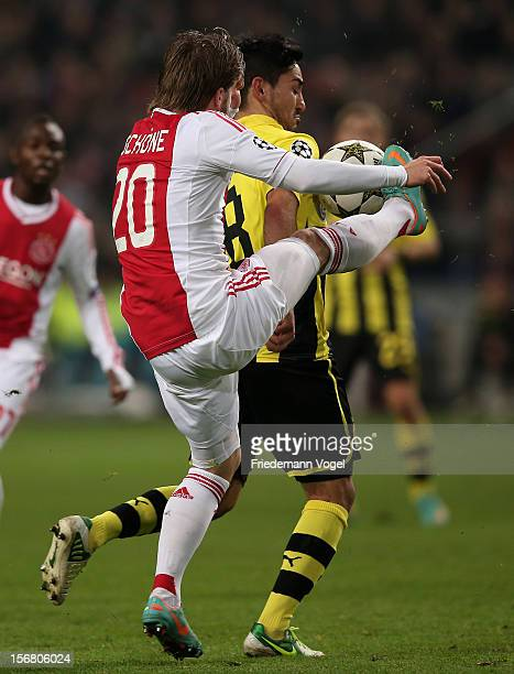 Ilkay Guendogan of Dortmund and Lasse Schone of Ajax battle for the ball during the UEFA Champions League Group D match between Ajax Amsterdam and...