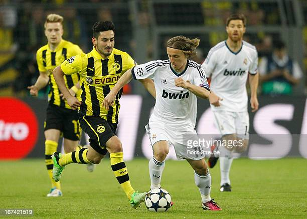 Ilkay Guendogan of Dortmund battles for the ball with Luka Modric of Madrid during the UEFA Champions League semi final first leg match between...