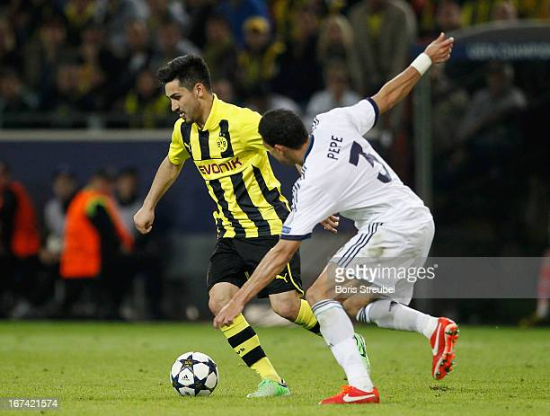 Ilkay Guendogan of Dortmund battles for the ball with Pepe of Madrid during the UEFA Champions League semi final first leg match between Borussia...