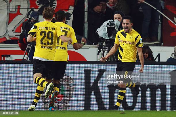 Ilkay Guendogan of Dortmund celebrates his team's second goal with team mates PierreEmerick Aubameyang and Marcel Schmelzer during the Bundesliga...