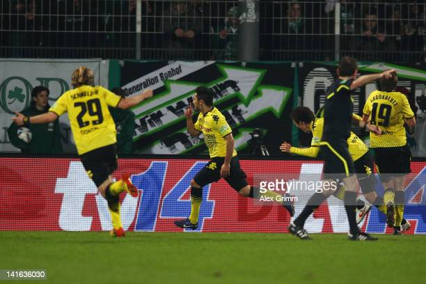 Ilkay Guendogan of Dortmund celebrates his team's winning goal with team mates Marcel Schmelzer Ivan Perisic and Kevin Grosskreutz during the DFB Cup...