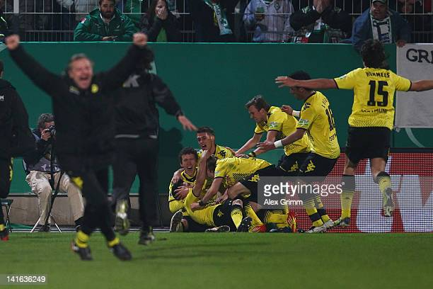 Ilkay Guendogan of Dortmund celebrates his team's winning goal with team mates during the DFB Cup semi final match between SpVgg Greuther Fuerth and...