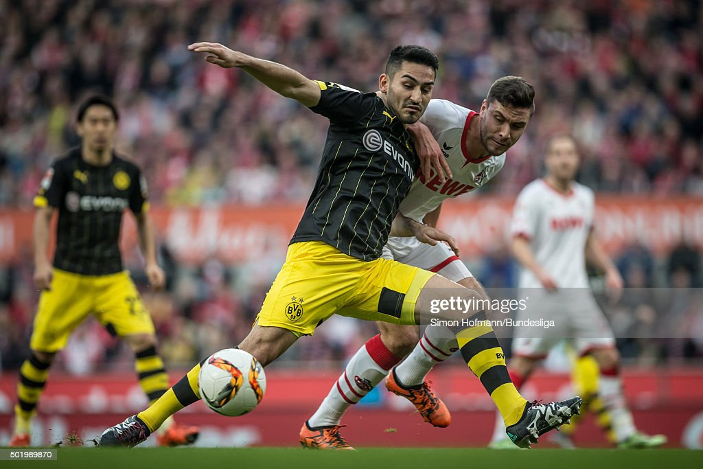 Ilkay Guendogan of Dortmund is challenged by Jonas Hector of Koeln during the Bundesliga match between 1. FC Koeln and Borussia Dortmund at RheinEnergieStadion on December 19, 2015 in Cologne, Germany.