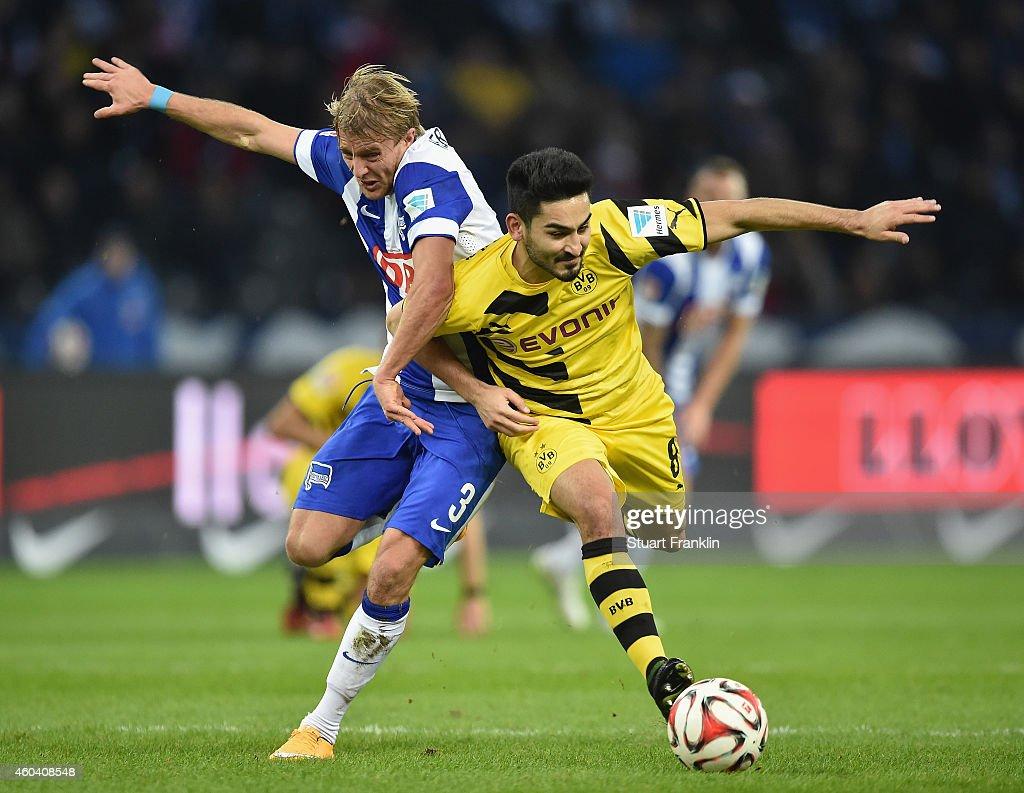 Ilkay Guendogan of Dortmund is challenged by Per Ciljan Skjelbred of Berlin during the Bundesliga match between Hertha BSC and Borussia Dortmund at Olympiastadion on December 13, 2014 in Berlin, Germany.