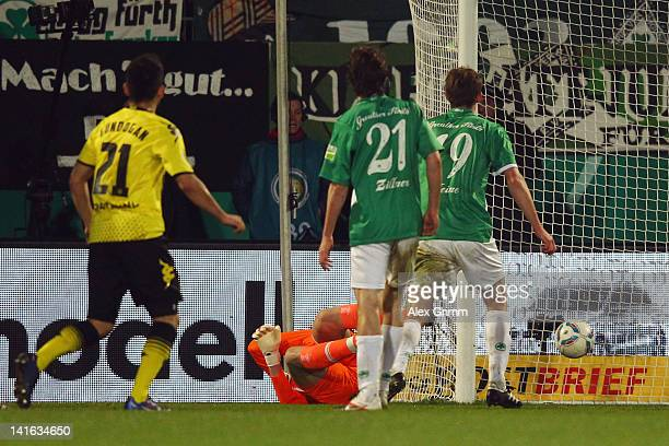 Ilkay Guendogan of Dortmund scores his team's first goal during the DFB Cup semi final match between SpVgg Greuther Fuerth and Borussia Dortmund at...