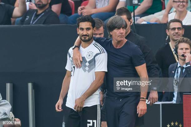 Ilkay Guendogan of Germany and coach Joachim Loew of Germany during the international friendly match between Germany and Saudi Arabia at BayArena on...