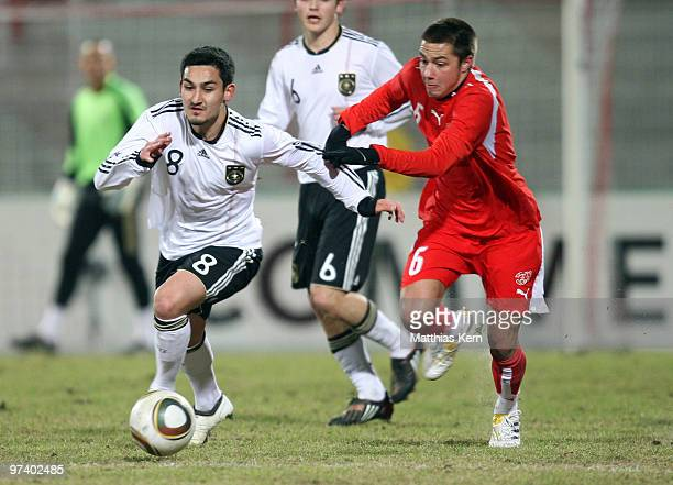 Ilkay Guendogan of Germany battles for the ball with Alain Wiss of Switzerland during the U20 international friendly match between Germany and...