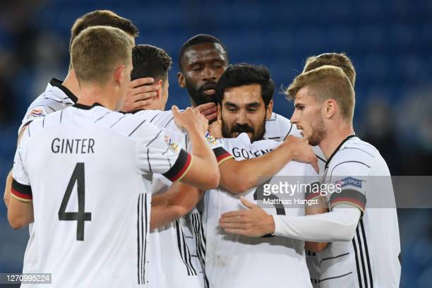 Ilkay Guendogan of Germany celebrates his team's first goal with teammates during the UEFA Nations League group stage match between Switzerland and...