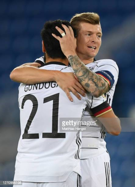 Ilkay Guendogan of Germany celebrates his team's first goal with teammate Toni Kroos during the UEFA Nations League group stage match between...
