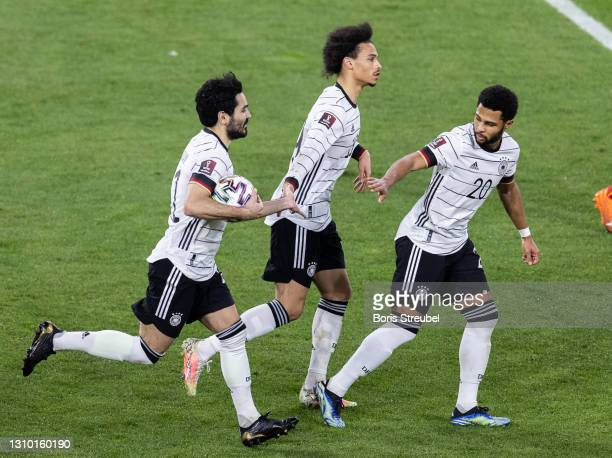 Ilkay Guendogan of Germany celebrates with teammates after scoring his team's first goal by penalty during the FIFA World Cup 2022 Qatar qualifying...