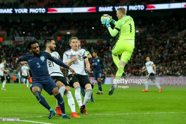Ilkay Guendogan of Germany Matthias Ginter of Germany and Danny Rose of England Goalkeeper Jordan Pickford of England battle for the ball during the...