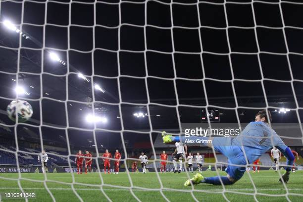 Ilkay Guendogan of Germany scores his team's first goal from the penalty spot during the FIFA World Cup 2022 Qatar qualifying match between Germany...