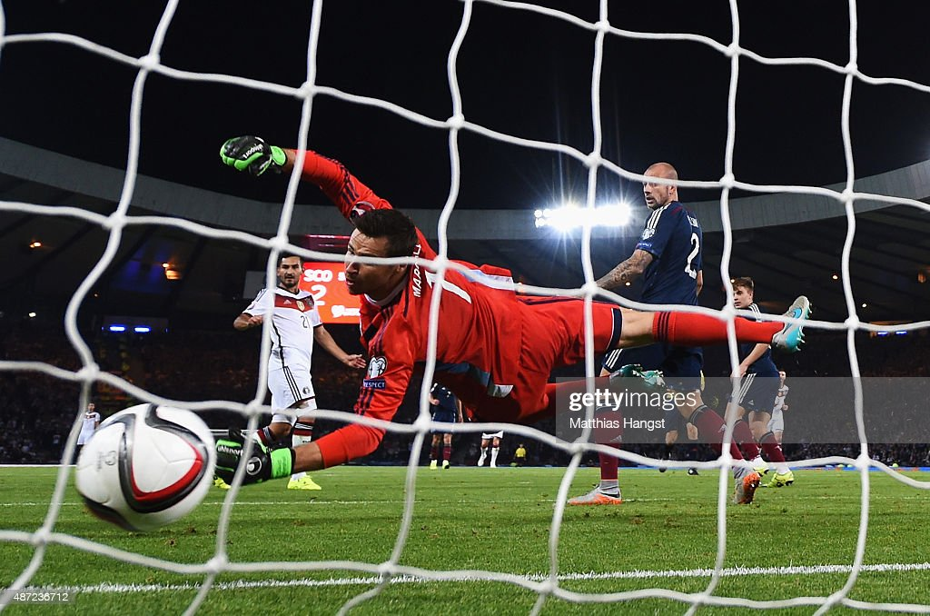 Ilkay Guendogan of Germany scores past David Marshall of Scotland for his team's third goal during the UEFA EURO 2016 Qualifier Group D match between Scotland and Germany at Hampden Park on September 7, 2015 in Glasgow, Scotland.