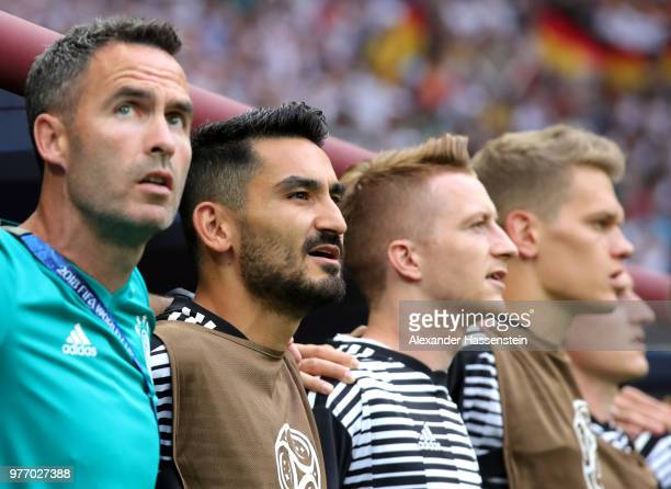 Ilkay Guendogan of Germany sings the national anthem from the bench prior to the 2018 FIFA World Cup Russia group F match between Germany and Mexico...