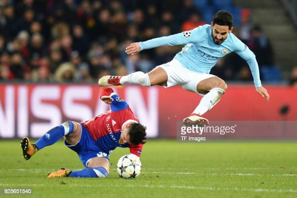Ilkay Guendogan of Manchester City and Taulant Xhaka of Basel battle for the ball during the UEFA Champions League Round of 16 First Leg match...