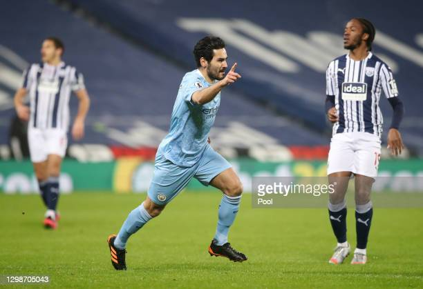 Ilkay Guendogan of Manchester City celebrates after scoring their team's firs goal during the Premier League match between West Bromwich Albion and...