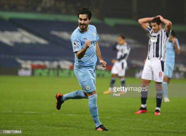 Ilkay Guendogan of Manchester City celebrates after scoring their team's third goal during the Premier League match between West Bromwich Albion and...
