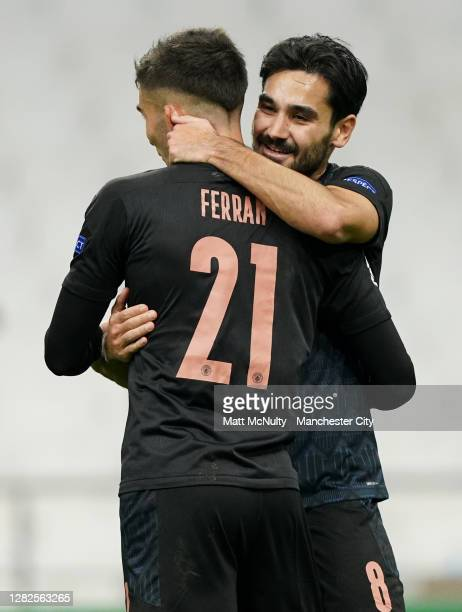 Ilkay Guendogan of Manchester City celebrates with Ferran Torres of Manchester City after scoring his teams second goal during the UEFA Champions...