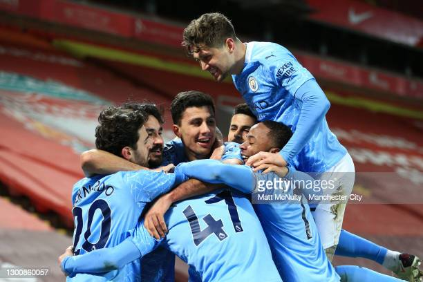 Ilkay Guendogan of Manchester City celebrates with John Stones and teammates after scoring their team's second goal during the Premier League match...
