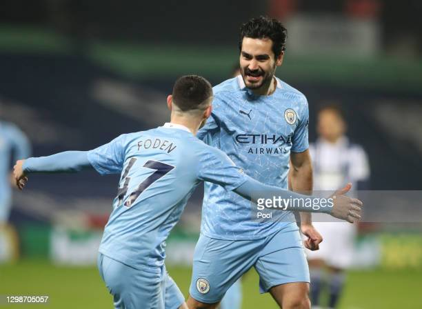 Ilkay Guendogan of Manchester City celebrates with Phil Foden after scoring their team's first goal during the Premier League match between West...