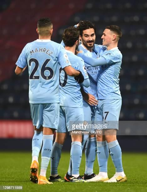Ilkay Guendogan of Manchester City celebrates with team mates Riyad Mahrez, Bernardo Silva and Phil Foden after scoring their team's third goal...