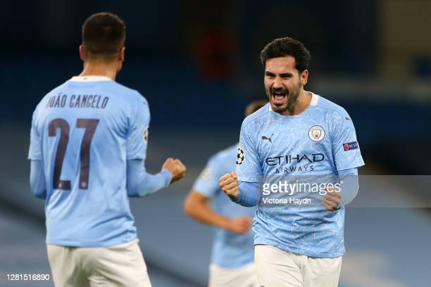 Ilkay Guendogan of Manchester City celebrates with teammate Joao Cancelo after scoring his team's second goal during the UEFA Champions League Group...
