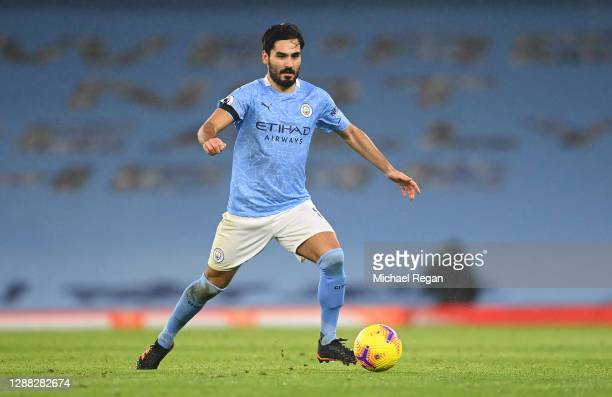 Ilkay Guendogan of Manchester City runs with the ball during the Premier League match between Manchester City and Burnley at Etihad Stadium on...