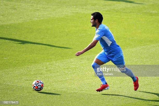 Ilkay Guendogan of Manchester City runs with the ball during the pre-season friendly match between Manchester City and Blackpool at Manchester City...