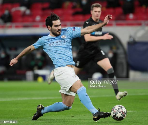 Ilkay Guendogan of Manchester City scores their team's second goal during the UEFA Champions League Round of 16 match between Manchester City and...
