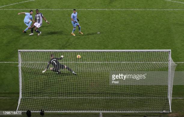 Ilkay Guendogan of Manchester City scores their team's third goal past Sam Johnstone of West Bromwich Albion during the Premier League match between...