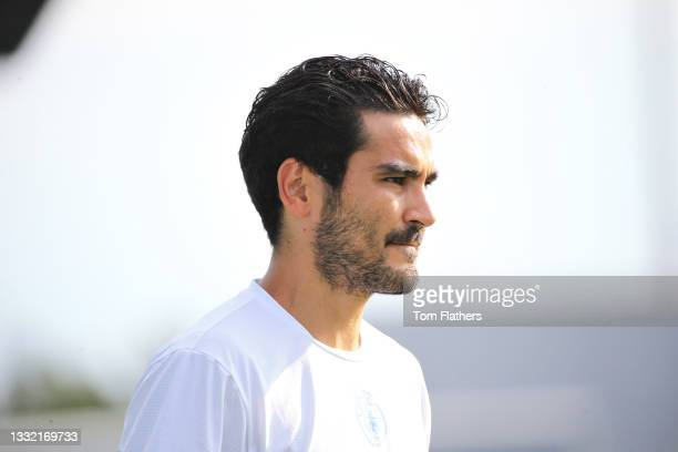 Ilkay Guendogan of Manchester City warms up ahead of the pre-season friendly match between Manchester City and Blackpool at Manchester City Football...