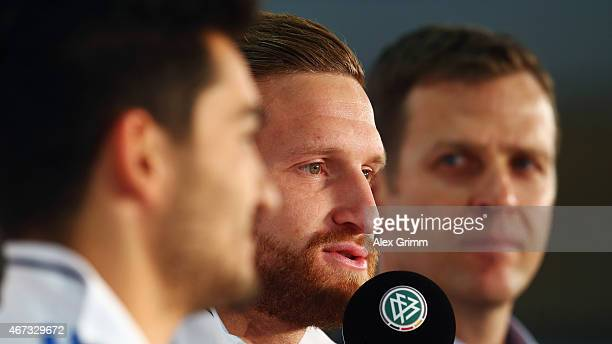 Ilkay Guendogan Shkodran Mustafi and Oliver Bierhoff manager of the German national team attend a Germany press conference at the DFB headquarters on...