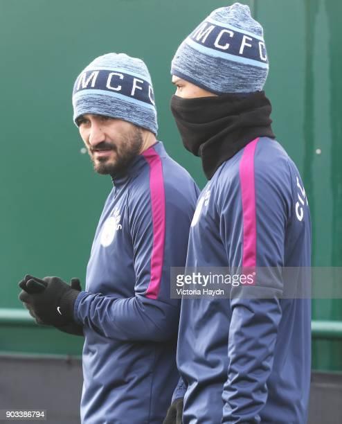 Ilkay Gundogan and Leroy Sane walk to training at Manchester City Football Academy on January 10 2018 in Manchester England