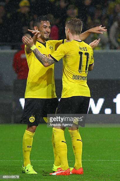 Ilkay Gundogan and Marco Reus of Borussia Dortmund celebrate after scoring a goal during the UEFA Europa League play off soccer match between...