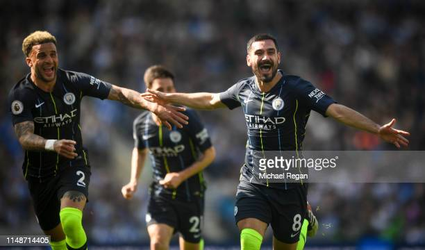 Ilkay Gundogan celebrates with Kyle Walker after scoring a goal during the Premier League match between Brighton Hove Albion and Manchester City at...
