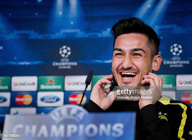 Ilkay Gundogan of Borussia Dortmund smiles as he listens to questions from the media during a press conference ahead of the UEFA Champions League...