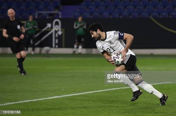 Ilkay Gundogan of Germany celebrates after scoring their side's first goal from the penalty spot during the FIFA World Cup 2022 Qatar qualifying...