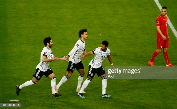 Ilkay Gundogan of Germany celebrates with teammates Serge Gnabry and Leroy Sane after scoring their team's first goal from the penalty spot during...