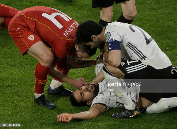 Ilkay Gundogan of Germany checks on team mate Emre Can with Darko Velkovski of North Macedonia during the FIFA World Cup 2022 Qatar qualifying match...