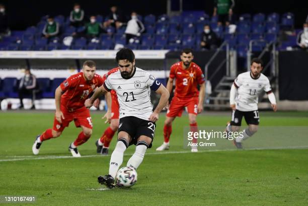 Ilkay Gundogan of Germany scores their side's first goal from the penalty spot during the FIFA World Cup 2022 Qatar qualifying match between Germany...