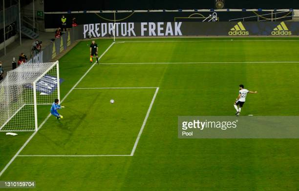 Ilkay Gundogan of Germany scores their team's first goal from the penalty spot during the FIFA World Cup 2022 Qatar qualifying match between Germany...