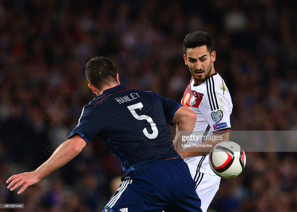 Ilkay Gundogan of Germany takes on Grant Hanley of Scotland during the EURO 2016 Qualifier between Scotland and Germany at Hamden Park on September 7, 2015 in Glasgow, Scotland.