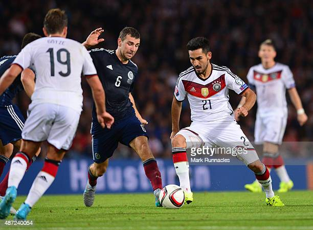 Ilkay Gundogan of Germany takes on James McAurthur of Scotland during the EURO 2016 Qualifier between Scotland and Germany at Hamden Park on...