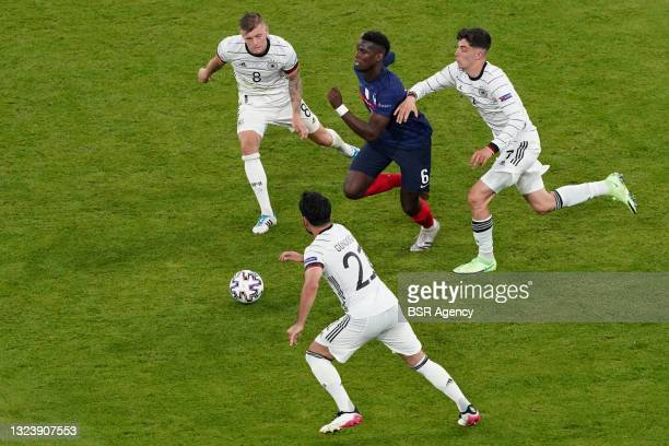 Ilkay Gundogan of Germany, Toni Kroos of Germany, Paul Pogba of France during the UEFA Euro 2020 match between France and Germany at Allianz Arena on...