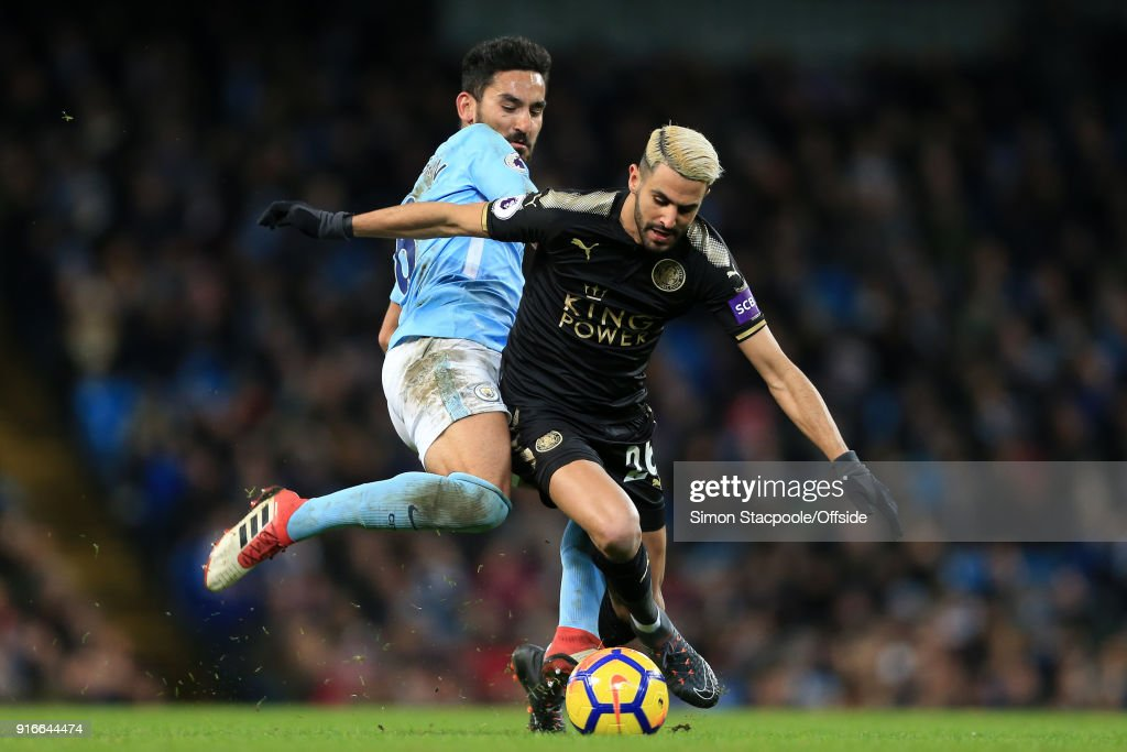 Ilkay Gundogan of Man City battles with Riyad Mahrez of Leicester during the Premier League match between Manchester City and Leicester City at the Etihad Stadium on February 10, 2018 in Manchester, England.