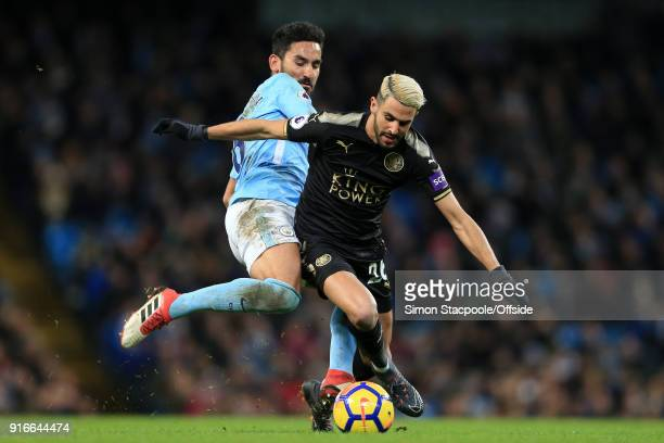 Ilkay Gundogan of Man City battles with Riyad Mahrez of Leicester during the Premier League match between Manchester City and Leicester City at the...