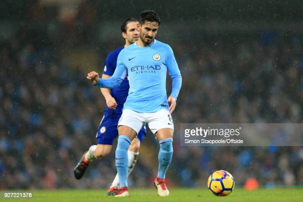 Ilkay Gundogan of Man City in action during the Premier League match between Manchester City and Chelsea at the Etihad Stadium on March 4 2018 in...