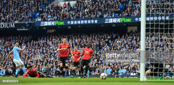 Ilkay Gundogan of Man City scores their 2nd goal during the Premier League match between Manchester City and Manchester United at the Etihad Stadium...