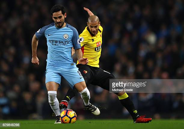 Ilkay Gundogan of Manchester City and Adlene Guedioura of Watford compete for the ball during the Premier League match between Manchester City and...